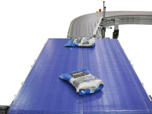 two 2200 Modular Belt conveyors moving at different speeds moving pouches