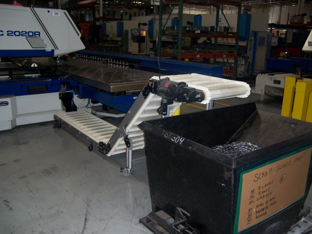 Dorner LPZ Series conveyors catch the scrap metal move to large bins